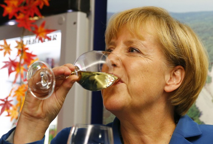 German Chancellor Merkel drinks wine as celebrates after German general election at CDU headquarters in Berlin