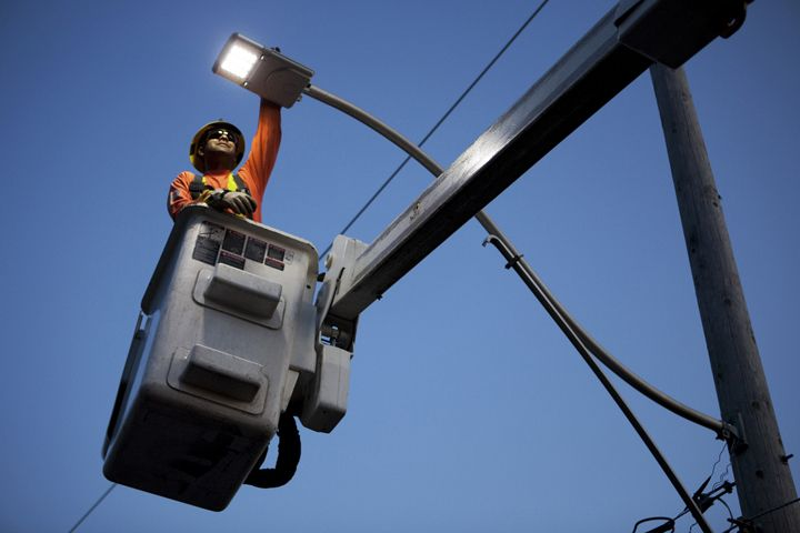 A Toronto Hydro employee installs LED lights on Delaware Street in Toronto, Canada. Delaware Street is home to an LED pilot project whereby Toronto Hydro is testing LED lights in residential neighborhoods.